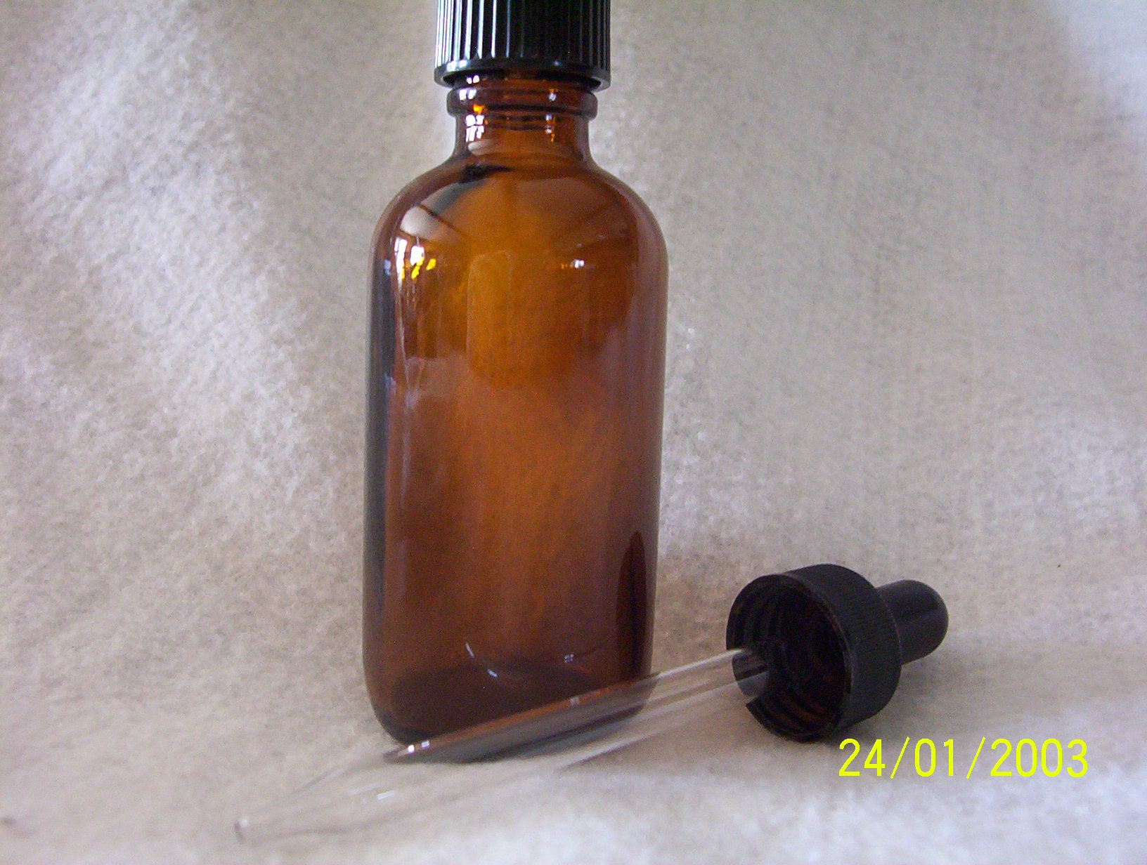 2 oz. Amber glass bottle with black cap